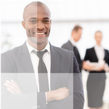Businessman standing in front of 2 colleagues