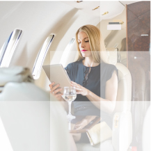 Businesswomen using her tablet inside airplane