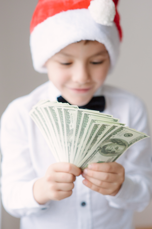 child with Christmas money